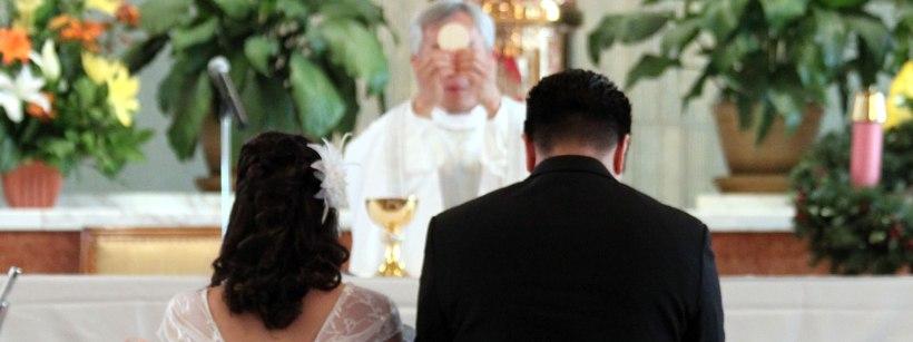 WeddingKneelingBeforeEucharist.jpg
